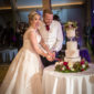 mill barns cutting the cake wedding photography